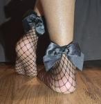 worn fishnet socks